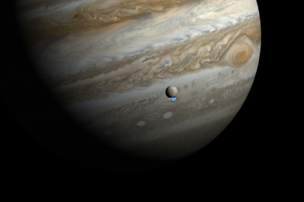 This artist's impression shows Jupiter and its moon Europa using actual Jupiter and Europa images in visible light. The Hubble ultraviolet images showing the faint emission from the water vapour plumes have been superimposed, respecting the size but not the brightness of the plumes. Astronomers using Hubble have detected signs of water vapour being vented off this moon, creating variable plumes near its south pole — the first observational evidence of water vapour being ejected off the moon's surface.